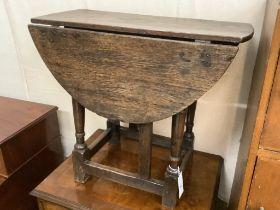 An early oak gateleg occasional table, width 60cm, depth 29cm, height 53cm