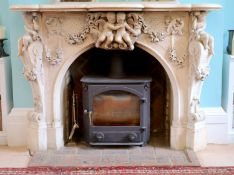 An important mid 19th century Italian white Carrara marble chimney piece,carved in the rococo