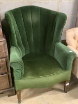 A George III mahogany wing armchair, on squared tapered legs, width 75cm
