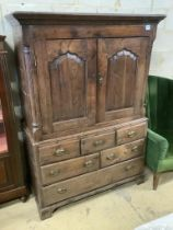 A mid 18th century oak two part bow fronted Dower chest / linen press, with doors enclosing shelves