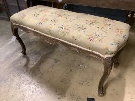 A late Victorian carved and stained beech dressing stool, width 97cm