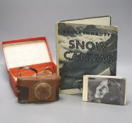 A Leica standard camera, number 145405 (1934), with leather case and a book