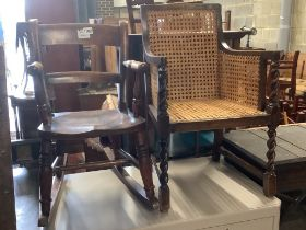 A Victorian mahogany child's rocking chair, height 60cm and a 1920's child's caned armchair, height