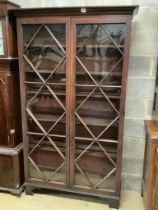 A George III mahogany bookcase with two astragal glazed doors, on later feet, width 116cm