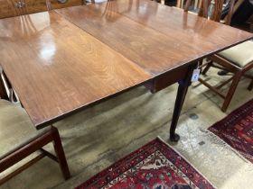 A George III mahogany gateleg table on pad feet, 136cm extended, width 113cm, height 71cm