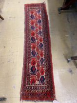 A North West Persian cream ground small rug, 39 x 159cm