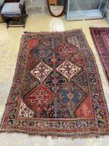 A Caucasian black ground rug, 237 x 159cm