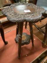 An early 20th century Indian carved hardwood occasional table, width 32cm height 54cm