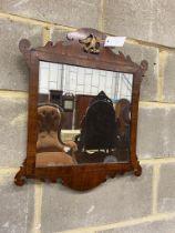 A George III style mahogany fret cut wall mirror