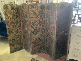 A Spanish leather folding six panel draught screen, with embossed floral printed card panels,