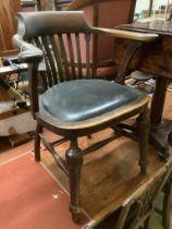An early 20th century oak desk chair, width 66cm