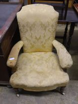 A Victorian upholstered open armchair, width 70cm, depth 76cm, height 94cm