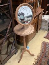 An Edwardian oak shaving stand, with telescopic plate, height approx. 133cm