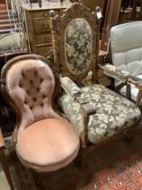 A Victorian mahogany buttonback nursing chair and a carved oak armchair