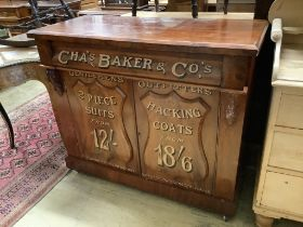 A tailor's bespoke carved mahogany shop cabinet, fitted two panelled doors, inscribed to the front