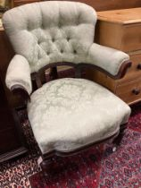 A Victorian carved mahogany upholstered armchair, width 72cm, depth 64cm, height 91cm