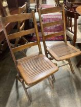 A set of eight early 20th century beech folding garden chairs
