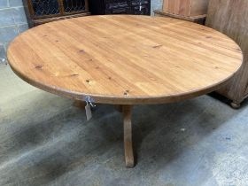 A Victorian style circular pine breakfast table, diameter 152cm height 71cm, together with a ply