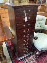 A contemporary hardwood ten drawer narrow chest, width 45cm, depth 45cm, height 125cm