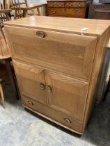 An Ercol elm fall front cabinet, width 82cm depth 44cm height 110cm