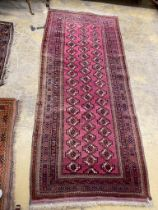 A Tekke Bokhara red ground rug, 254 x 109cm, together with a machined rug