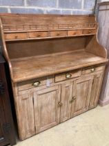 A Victorian pine dresser (lacks rack), length 138cm, depth 52cm, height 152cm