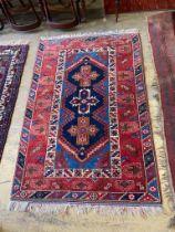 A Caucasian design rug, 184 x 120cm