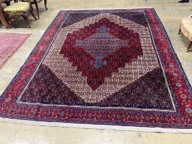 A Feraghan pattern red ground carpet, 320 x 250cm