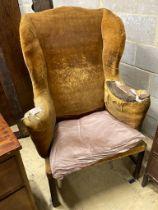 A George III provincial wing armchair, width 83cm, depth 60cm, height 124cm