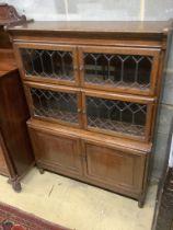 A 1920's leaded oak sectional bookcase, width 90cm