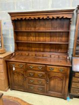 A reproduction 18th century style oak dresser, width 152cm, depth 54cm, height 198cm