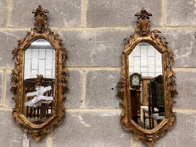 A pair of carved giltwood wall mirrors, width 30cm, height 74cm