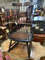 A Windsor beech rocking chair, width 59cm, depth 45cm, height 106cm