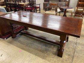An 18th century style oak refectory dining table, length 228cm, depth 91cm, height 76cm