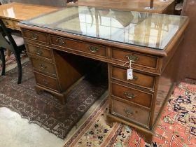 A Georgian style walnut desk with triple skiver, width 123cm depth 72cm height 74cm