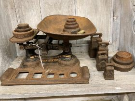 A set of Avery scales, width 40cm and weights, together with additional weights