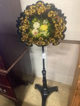 A Victorian ebonised pole screen with papier mache banner, height 130cm
