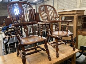 A near pair of 19th century ash and elm Yorkshire Windsor armchairs, larger width 63cm, depth 48cm,