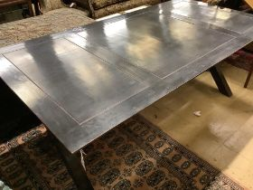 A contemporary ebonised dining table, width 200cm depth 100cm height 77cm