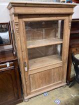 A 19th century East European pine vitrine, width 104cm, depth 52cm, height 170cm