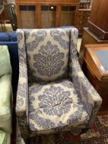 A contemporary armchair with silver/ blue patterned fabric, width 74cm, depth 76cm, height 100cm