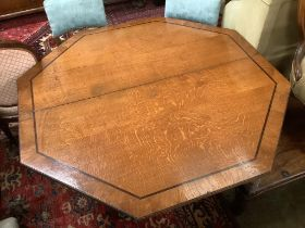A Regency oak and ebony line inlaid octagonal topped breakfast table, width 138cm, height 72cmBy