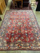 A Caucasian design red ground carpet, 310 x 224cm