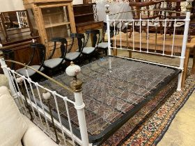A Victorian style brass and painted iron porcelain mounted bed frame, width 150cm, length 210cm