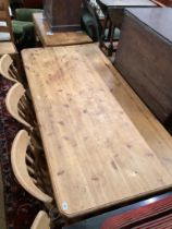 A Victorian style rectangular pine kitchen table, length 180cm, width 86cm, height 77cm and four
