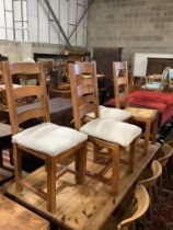 A set of four rush seated dining chairs