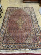 A North West Persian style peach ground carpet, 300 x 206cm