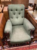 A Victorian mahogany framed armchair, in pale blue upholstery