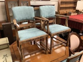 A set of six 1920's oak dining chairs two with arms