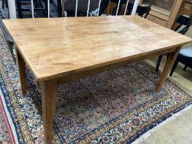 A rectangular pine kitchen table, width 160cm, depth 79cm, height 75cm